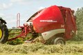 A Round Baler Making Hay Bale  Bales During Harvesting Stock Photography - 55181432