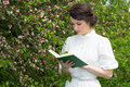 Beautiful Woman Reading Book In Blooming Spring Garden Royalty Free Stock Photos - 55241408
