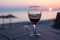 Glass With Red Wine And Sunset On Beach  At The Background. Summertime Vacation Concept Royalty Free Stock Photography - 55253137