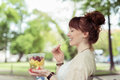 Thoughtful Lady Eating Fresh Healthy Fruit Salad Royalty Free Stock Photography - 55301337