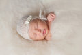 Newborn Baby Girl Wearing A White Knitted Bonnet Stock Images - 55304084