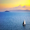 Elba Island Sunset View From Piombino An Sail Boat. Mediterranea Royalty Free Stock Images - 55315219