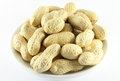 Handful Of Peanuts In The Shell On A White Porcelain Dish Royalty Free Stock Image - 55323816