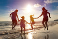Happy Family Jumping  On The Beach Royalty Free Stock Photo - 55325505