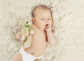 Sweet Baby At Home Sleeping With Teddy Bear Stock Photo - 55329370