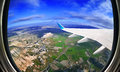 View From Airplane Window On Fields And Mountains Stock Images - 55343224