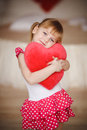 Portrait Of Little Girl Holding Red Heart Royalty Free Stock Photography - 55345307