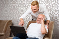 Grandson Behind His Grandfather With Laptop Stock Photography - 55351542