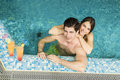 Young Couple In The Swimming Pool Stock Image - 55361151
