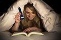 Woman Reading Book Holding Torch Royalty Free Stock Photos - 55366108