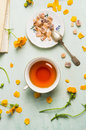 Cup Of Tea With Brown Candi Sugar And Flowers Stock Photos - 55370363
