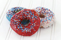 Glazed Donuts In Blue, Red And White Stock Photo - 55398800