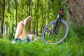 Young Cyclist Relaxation Lying In The Grass Royalty Free Stock Images - 55401729