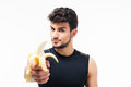 Handsome Young Man Holding Banana Royalty Free Stock Image - 55410006