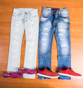 His And Hers Blue Jeans Laid With Shoes Stock Photos - 55426533