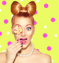 Beauty Girl Eating Colourful Lollipop Stock Photography - 55435432