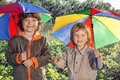 Happy Brother With Umbrella Outdoors Royalty Free Stock Image - 55451186