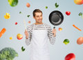 Happy Man Or Cook In Apron With Pan And Spoon Royalty Free Stock Photos - 55453178