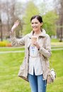 Smiling Woman Drinking Coffee In Park Royalty Free Stock Photography - 55454257
