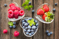Mix Of Fresh Berries In Three  Glass Ramekins In Shape Of Heart, Stock Photography - 55462992