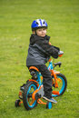 Happy Kid With Bike In Park Royalty Free Stock Images - 55468289