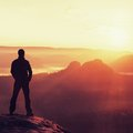 Hiker Stand On The Sharp Corner Of Sandstone Rock In Rock Empires Park And Watching Over The Misty And Foggy Morning Valley To Sun Royalty Free Stock Images - 55468629