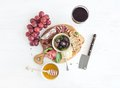Wine Appetizer Set. Glass Of Red, Grapes, Parmesan Stock Photo - 55485820