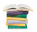 Open Book On A Pile Of Vintage Books In Multicolored Covers Stock Photo - 55497260