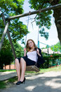 Portrait Of The Young Girl On A Swing Stock Images - 5551344