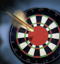 Dart Heading For Dartboard With A Large Bulls Eye. Stock Photo - 5556720