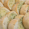 Sliced Garlic And Herb Bread Royalty Free Stock Images - 5557439