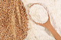 White Flour In A Wooden Spoon And Ears Of Wheat Stock Image - 55510141
