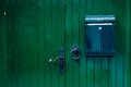Green Wooden Door With Mailbox Royalty Free Stock Image - 55527676