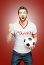 Polish Fan Holding A Soccer Ball Celebrates On Red Background Stock Image - 55537581