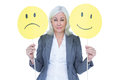 Businesswoman Holding A Sad And A Happy Smiley Stock Photo - 55559280