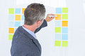 Puzzled Businessman Looking Post Its On The Wall Royalty Free Stock Photos - 55559398
