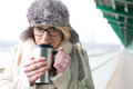 Portrait Of Woman Drinking Coffee From Insulated Drink Container During Winter Royalty Free Stock Photography - 55570927