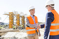 Engineers Shaking Hands At Construction Site Against Clear Sky Royalty Free Stock Images - 55574979