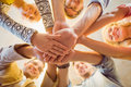 Happy Business Team Joining Their Hands Royalty Free Stock Images - 55576679