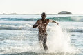 Sports Man Running In Water Royalty Free Stock Image - 55577026