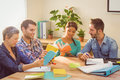 Group Of Colleagues Reading Books Stock Images - 55578084