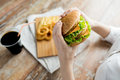 Close Up Of Woman Hands Holding Hamburger Stock Photo - 55594240