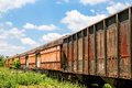 Old Rusty Train Cars Curving Stock Photo - 55597040
