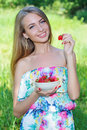 Happy Girl With Strawberries Stock Image - 55599601