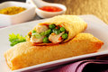 Two Delicious Spring Rolls With Fresh Vegetables Royalty Free Stock Photo - 55639265