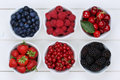 Berry Fruits In Bowls With Strawberries, Blueberries And Cherrie Stock Photos - 55653333
