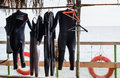 Wet Suits Hanging To Dry On Boat Deck Stock Image - 55656241