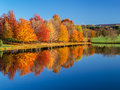 Reflection Of  A Colorful Autumn Landscape Royalty Free Stock Image - 55661326