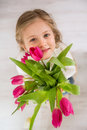 Little Girl With Bouquet Of Tulips Stock Images - 55661524