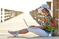 Young Woman Using Laptop Outdoor In Summer Royalty Free Stock Image - 55680456